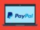 Im Comic-Stil gezeichneter Laptop, auf dem das Markenlogo von PayPal zu sehen ist.